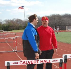 Dr. Detterline speaks to track coach at Calvert Hall
