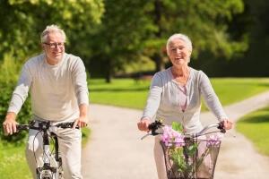 Happy elderly couple riding bicycles