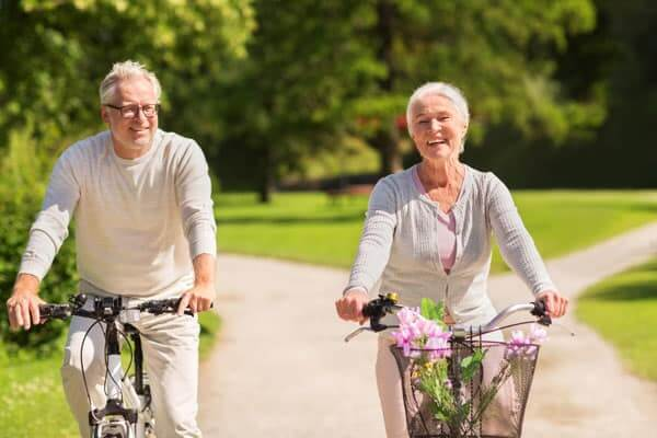Happy elderly couple riding bicycles