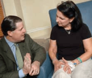 Dr. Dalury speaks with patient following total knee replacement