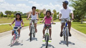 Parents and children riding bicycles