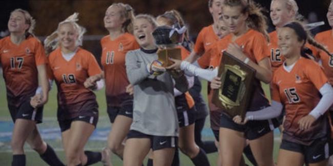 girls soccer team winning championship