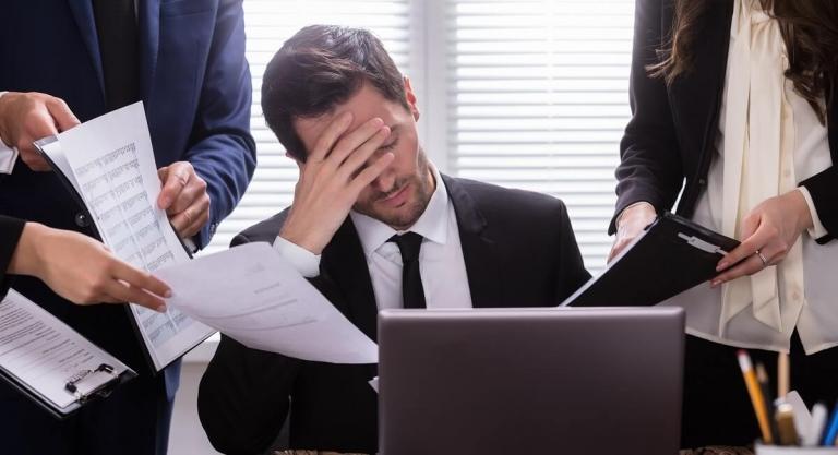 Man showing stress at desk
