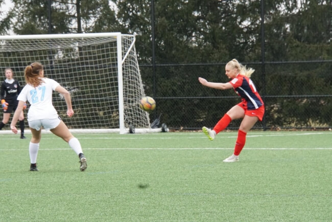 girls playing in a soccer match