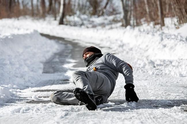 Man falling on winter ice
