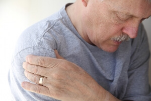 Man suffering from shoulder pain